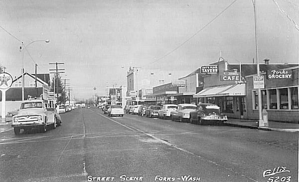 A postcard featuring downtown Forks, the Art's Place sign can be seen on the right side of the photo. Bob Stark has recreated a similar sign that will go over the door of the newest display at the Forks Timber Museum.